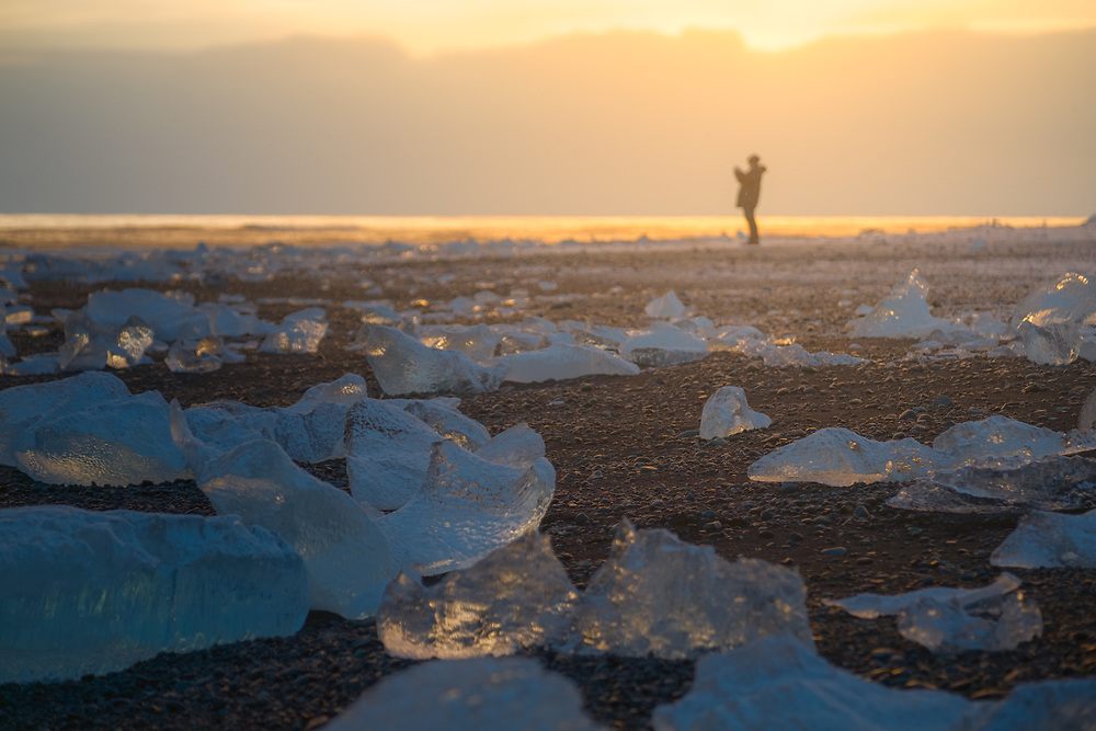They say, it rains diamonds on Jupiter and Saturn. The closest we can get to that on earth is at Jökulsárlón Ice Beach in Iceland. The huge blocks of ice that calve from the edge of Vatnajökull - the largest and most voluminous ice cap in Iceland - are about 30 metres (98 ft) high which fills the lagoon stocked with icebergs. Smaller pieces of ice find their way to the black sand beach, which makes it look like someone dropped a handful of oversized diamonds from the sky.