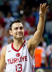 Ender Arslan of Turkey celebrates during  the eight-final basketball match between National teams of Turkey and France at 2010 FIBA World Championships on September 5, 2010 at the Sinan Erdem Dome in Istanbul, Turkey. (Photo By Vid Ponikvar / Sportida.com)