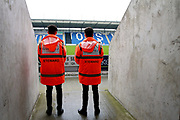 Stewards in one of the fan gangways before the EFL Sky Bet League 2 match between Colchester United and Luton Town at the Weston Homes Community Stadium, Colchester, England on 30 March 2018. Picture by Nigel Cole.