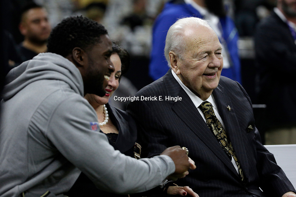 Jan 7, 2018; New Orleans, LA, USA; New Orleans Saints former running back Reggie Bush (left) shakes hands with Saints owner Tom Benson (right) as Gayle Benson (middle) looks on before the NFC Wild Card playoff football game against the Carolina Panthers at Mercedes-Benz Superdome. Mandatory Credit: Derick E. Hingle-USA TODAY Sports