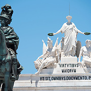 LISBON, Portugal - Statue of King Joseph I (1714-1777) by sculptor Joaquim Machado de Castro. It stands in the middle of the Praça do Comércio. Known as Commerce Square in English, Praça do Comércio is an historic square in the Pombaline Downtown district of Lisbon, next to the Tagus River. In the background is the top of the Arco da Rua Augusta. The sculptures on top of the Arch represent Glory rewarding Valor and Genius.