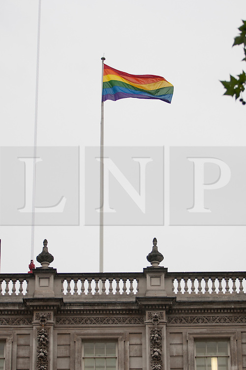 © licensed to London News Pictures. London, UK 06/07/2012. A rainbow flag flies above The Cabinet Office today in celebration of Worldpride. Photo credit: Tolga Akmen/LNP