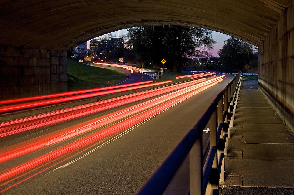Dusk descends on Arlington, Virginia and the nation's capital as seen from under the Arlington Memorial Bridge.