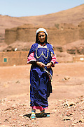 Portrait of a Berber lady wearing traditional Amazigh dress, standing outside the nTellah Granary, Taliouine province of the Souss Massa Draa, Southern Morocco, 2016-05-25.&nbsp;<br />