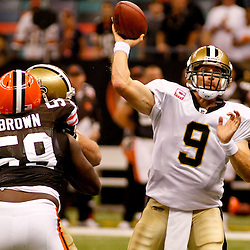Oct 24, 2010; New Orleans, LA, USA; New Orleans Saints quarterback Drew Brees (9) throws a pass against the Cleveland Browns during the second half at the Louisiana Superdome. The Browns defeated the Saints 30-17.  Mandatory Credit: Derick E. Hingle