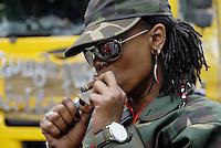 Woman smoking cigar Notting Hill Carnival 2008