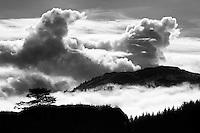 Tall, cumulus clouds and form near Kodiak, Alaska