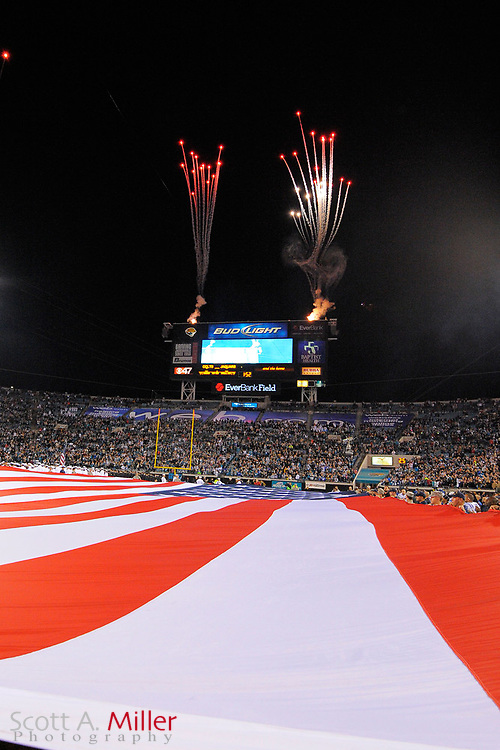Fireworks explode over the US Flag prior to an NFL football game between the Jacksonville Jaguars and the Indianapolis Colts at EverBank Field on November 8, 2012 in Jacksonville, Florida.  The Colts won 27-10. .©2012 Scott A. Miller..