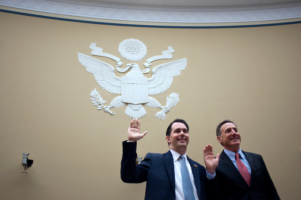"Gov. SCOTT WALKER (R-WI) and Gov. PETE SHUMLIN (D-VT) are sworn in during a House Oversight and Government Reform Committee Hearing on ""State And Municipal Debt: Tough Choices Ahead."" The Wisconsin Governor defended his efforts to limit public employees' collective bargaining rights and make them pay more toward pension and health care costs."