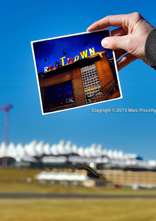 SHOT 2/7/13 2:50:04 PM - Exterior images of Denver International Airport (DEN) with a postcard of  RootDown restaurant. The popular LoHi eatery will be opened an outpost on the C Concourse at the airport in the coming months.(Photo by Marc Piscotty / © 2013)