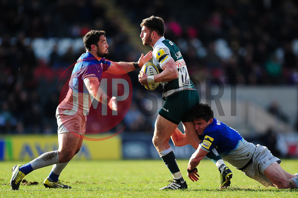 Owen Williams of Leicester Tigers is double-tackled by Brad Barritt and Nils Mordt of Saracens - Mandatory byline: Patrick Khachfe/JMP - 07966 386802 - 20/03/2016 - RUGBY UNION - Welford Road - Leicester, England - Leicester Tigers v Saracens - Aviva Premiership.