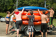 Students in the Fundamentals of Kayking class tie down their kayaks to a trailor after a day on Strouds Run.