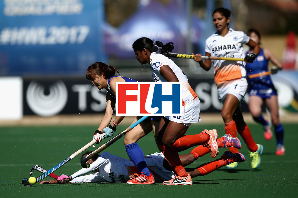 JOHANNESBURG, SOUTH AFRICA - JULY 20: Minami Shimizu of Japan attempts to keep possesion while under pressure from Nikki Pradhan of India and Sunita Lakra of India during the 5th-8th Place playoff match between India and Japan during Day 7 of the FIH Hockey World League - Women's Semi Finals on July 20, 2017 in Johannesburg, South Africa.  (Photo by Jan Kruger/Getty Images for FIH)
