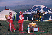 Jockeys before traditional blessing<br /> Naadam festival horse race<br /> Jockey's aged 4-12 years and most often girls<br /> Ulaanbaatar race track<br /> Mongolia