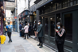© Licensed to London News Pictures. 04/07/2020. London, UK. Customers queue outside a restaurant in Chinatown after a relaxing of rules during the Covid-19 pandemic. Photo credit: Ray Tang/LNP.