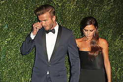 © Licensed to London News Pictures. FILE PICTURE. Victoria Beckham, David Beckham, London Evening Standard Theatre Awards, The London Palladium, London UK, 30 November 2014. Bookmakers have suspended bets on the Beckham's getting a divorce.  Photo credit: Richard Goldschmidt/LNP