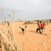 Children playing football at the Mbera camp for Malian refugees in Mauritania on 2 March 2013.