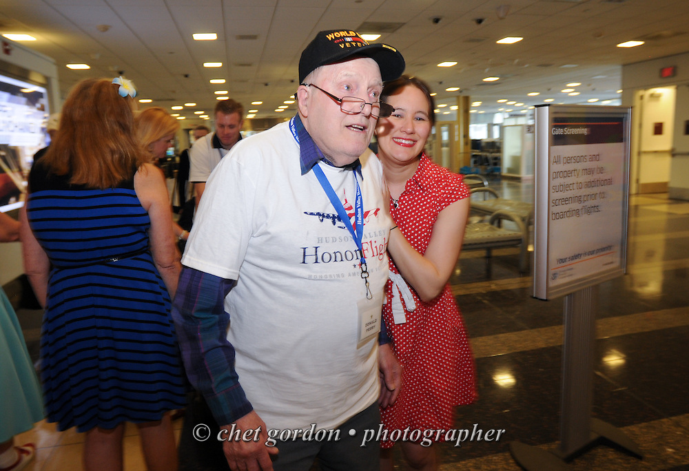 WWII Veterans and their escorts depart Reagan National Airport in Washington, DC during their Hudson Valley Honor Flight on Saturday, April 26, 2014. One Hundred WWII Veterans and their escorts from the Hudson Valley region of New York toured the WWII Memorial in Washington, DC and Arlington National Cemetery in Arlington, VA.  © www.chetgordon.com