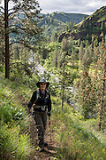 Hiker on Wenaha River Trail, Blue Mountains, Umatilla National Forest, Oregon, USA. For licensing options, please inquire.