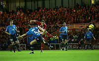 Photo: Andrew Unwin.<br />Middlesbrough v Dnipro. UEFA Cup. 03/11/2005.<br />Middlesbrough's Mark Viduka (C) fires home his team's second goal.