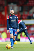 Bolton Wanderers defender Marc Wilson (18) warming up during the EFL Sky Bet Championship match between Brentford and Bolton Wanderers at Griffin Park, London, England on 22 December 2018.