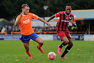 Chez Isaac of Braintree Town looks to get past Cameron Gayle of Oxford United during the FA Cup match between Braintree Town and Oxford United at the Avanti Stadium, Braintree<br /> Picture by Richard Blaxall/Focus Images Ltd +44 7853 364624<br /> 08/11/2015