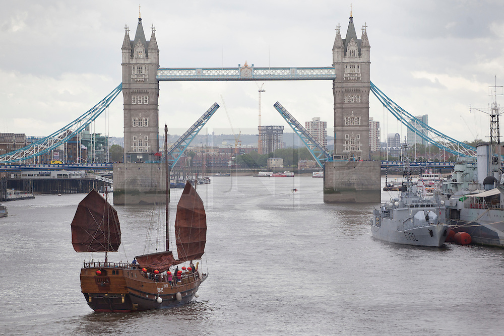 © licensed to London News Pictures. London, UK 15/06/2012. The Chinese ship Huan Tian saling to St Katharine's Docks after a short trip to London Bridge today. The ship had arrived four days late for the Diamond Jubilee celebrations it was set to take part in. The historic junk vessel, which was transported on a special carrier from Hong Kong, had been held up by traffic at the Suez Canal causing it to be delayed. The Huan Tian is now expected to remain for the Olympic Games, before being sailed back to Hong Kong. Photo credit: Tolga Akmen/LNP