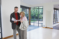 Couple reading brochure in new property
