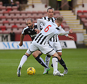 Dundee's Gary Harkins takes on Dunfermline's Andy Geggan  - Dunfermline Athletic v Dundee - Scottish League Cup at East End Park<br /> <br />  - © David Young - www.davidyoungphoto.co.uk - email: davidyoungphoto@gmail.com