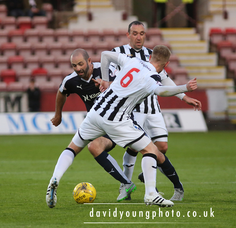 Dundee's Gary Harkins takes on Dunfermline's Andy Geggan  - Dunfermline Athletic v Dundee - Scottish League Cup at East End Park<br /> <br />  - &copy; David Young - www.davidyoungphoto.co.uk - email: davidyoungphoto@gmail.com