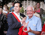 PHILADELPHIA - OCTOBER 1:  U.S. Senator Rick Santorum (R-Pa.) greets a supporter during the Pulaski Day Parade Oct. 1, 2006 in Philadelphia, Pennsylvania. Santorum faces Democratic challenger Bob Casey Jr. in the November election. (Photo by William Thomas Cain/Getty Images)