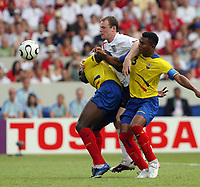 Photo: Chris Ratcliffe.<br /> <br /> England v Ecuador. 2nd Round, FIFA World Cup 2006. 25/06/2006.<br /> <br /> Wayne Rooney of England is floored by xx and xx of Ecuador.