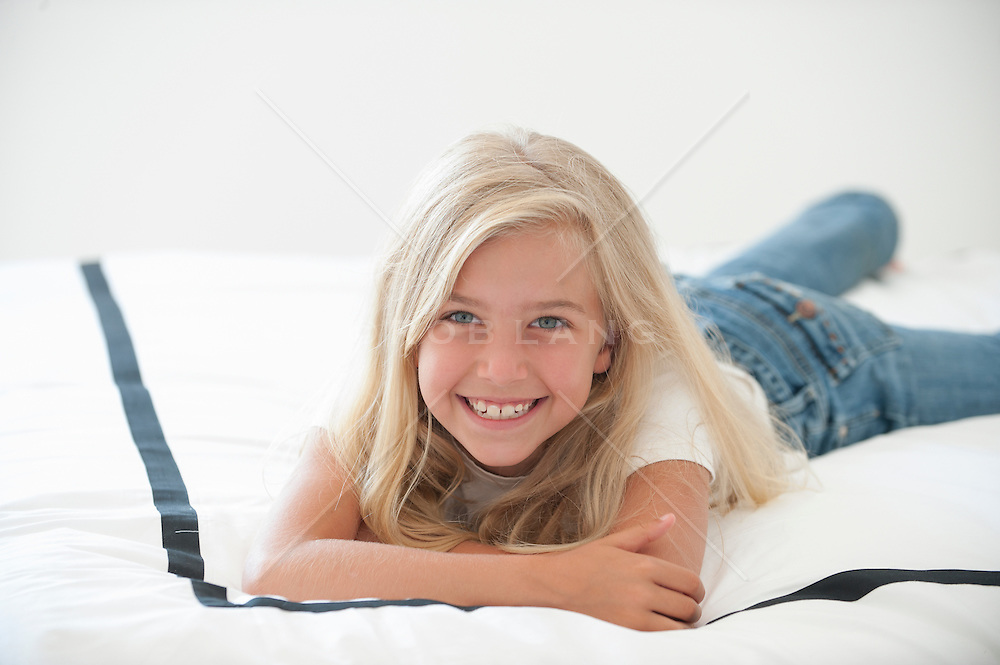 young blonde girl at home smiling