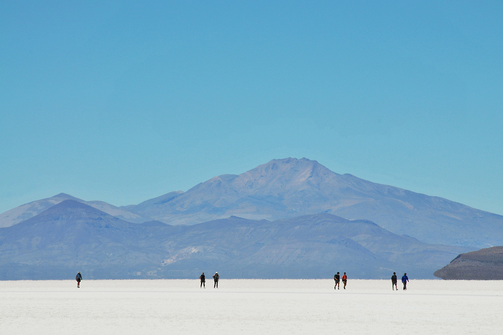 People walking across the Salar de Uyuni, Bolivia