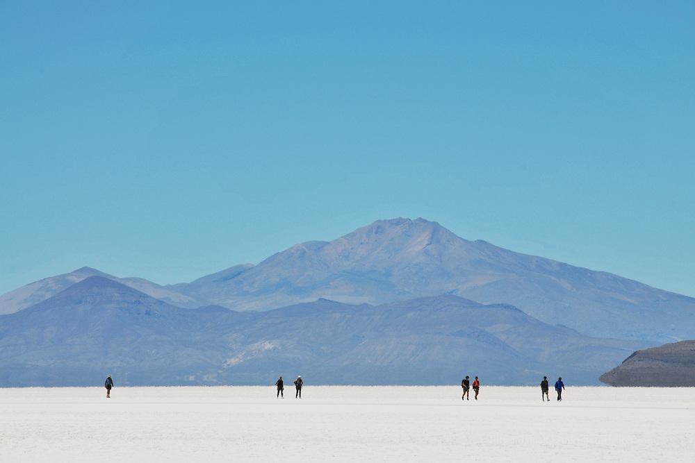 People walking across the Salar de Uyuni, Bolivia