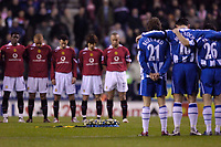 Photo: Jed Wee.<br /> Wigan Athletic v Manchester United. The Barclays Premiership. 06/03/2006.<br /> <br /> Manchester United and Wigan players observe a minute's silence in memory of Wigan serviceman Lee Ellis who died while serving in Iraq.