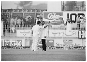 England captain Mike Gatting continues his confrontation with Pakistan Umpire Shakoor Rana during the 2nd Test Match, Pakistan v England at the Iqbal Stadium Faisalabad, 8.12.1987. Photograph: Graham Morris/cricketpix.com (Tel: +44 (0)20 8969 4192; Email: sales@cricketpix.com) Ref. No. 87663b15