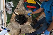 pest control. fumigating a sewerage manhole