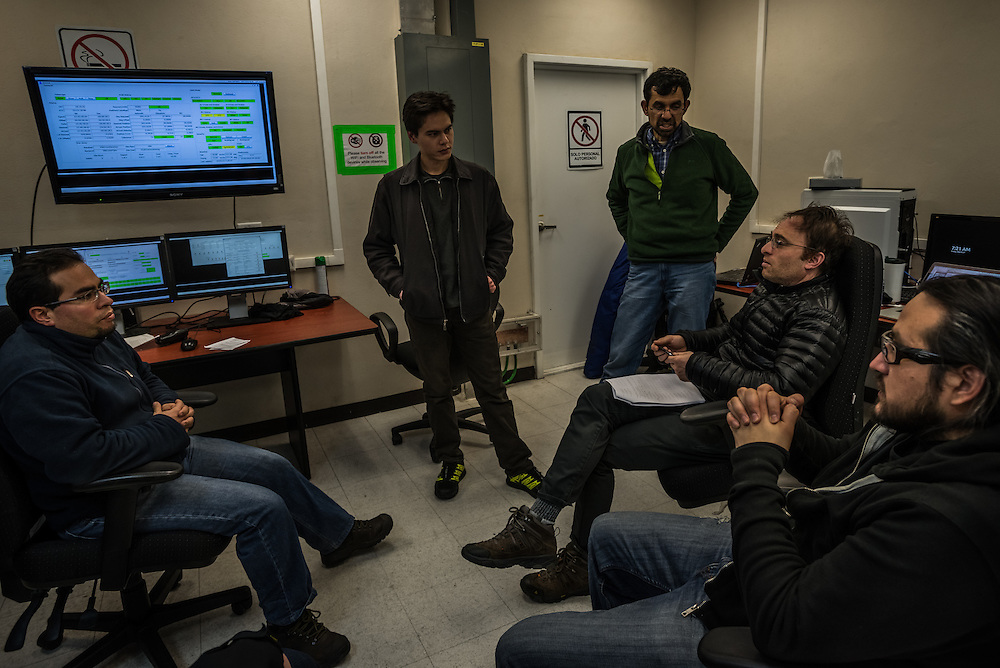 PICO DE ORIZABA NATIONAL PARK, PUEBLA, MEXICO - MARCH 27, 2015: Astronomer Sheperd Doeleman of MIT, (center) discusses with his team while monitoring the data being received inside the control room of the Large Millimeter Telescope after successfully connecting the LMT to several other telescopes around the world to make one large telescope called the Event Horizon Telescope, as large as the earth that the LMT team believes has the capacity to make the first image of the black hole.   CREDIT: Meridith Kohut for The New York Times