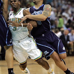 New Orleans Hornets guard Chris Paul #3 tries to get around a pick as he defends Deron Williams #8 of the Utah Jazz in the third quarter of their NBA game on April 8, 2008 at the New Orleans Arena in New Orleans, Louisiana.