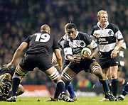2004_'The Gartmore Challenge' - Barbarians_vs_New-Zealand..Baabaa Radike Samo, looks for a way around all Black Mose Tuiali'i..04.12.2004 Photo  Peter Spurrier. .email images@intersport-images.com...