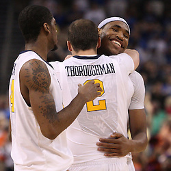 Mar 17, 2011; Tampa, FL, USA; West Virginia Mountaineers forward Cam Thoroughman (2) hugs West Virginia Mountaineers forward Kevin Jones (5) following a win over the Clemson Tigers in the second round of the 2011 NCAA men's basketball tournament at the St. Pete Times Forum. West Virginia defeated Clemson 84-76.  Mandatory Credit: Derick E. Hingle
