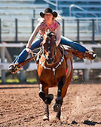 Courtney Ford urges her barrel racing horse toward the finish line at the 2009 Cheyenne Frontier Days held at Frontier Park in Cheyenne,Wyoming.