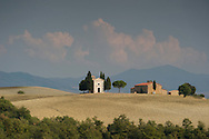The Chapel Vitaleta and cypress trees on the rolling hills of Val d'Orcia, Tuscany, Italy