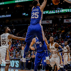 Dec 10, 2017; New Orleans, LA, USA; Philadelphia 76ers guard Ben Simmons (25) dunks over New Orleans Pelicans guard E'Twaun Moore (55) during the second half at the Smoothie King Center. The Pelicans defeated the 76ers 131-124. Mandatory Credit: Derick E. Hingle-USA TODAY Sports