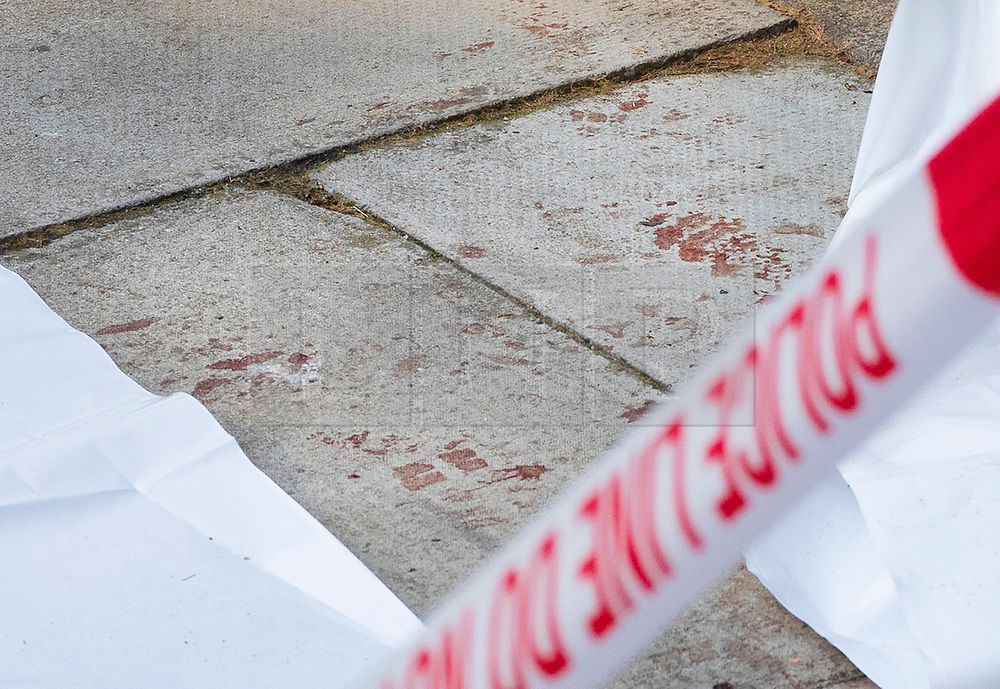 © Licensed to London News Pictures. 13/08/2019. London, UK. Spots of blood stain the pavement at the crime scene in Munster Square Camden where a male was stabbed to death last night. The victim, whose age has not yet been released, was pronounced dead at the scene after police were called shortly after 11pm. Photo credit: Peter Macdiarmid/LNP