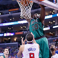 08 January 2014: Boston Celtics power forward Brandon Bass (30) dunks the ball over Los Angeles Clippers small forward Jared Dudley (9) during the Los Angeles Clippers 111-105 victory over the Boston Celtics at the Staples Center, Los Angeles, California, USA.