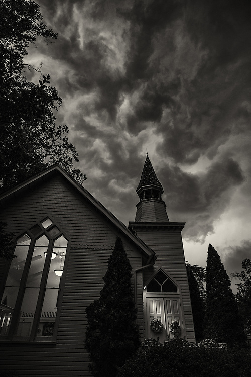 Roiling clouds over church in Historic Oella, Maryland. Shot on a Fuji X-Pro 2.