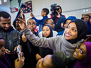 "16 MARCH 2019 - BLOOMINGTON, MINNESOTA, USA: Congresswoman ILHAM OMAR (D-MN) poses for ""selfies"" with people from her district at Dar al Farooq Center in Bloomington. She is the first Somali-American elected to congress. An interdenominational crowd of about 1,000 people came to the center to protest white supremacy and religious intolerance and to support Muslims in New Zealand who were massacred by a white supremacist Friday. The Twin Cities has a large Muslim community following decades of Somali immigration to Minnesota. There are about 45,000 people of Somali descent in the Twin Cities.    PHOTO BY JACK KURTZ"