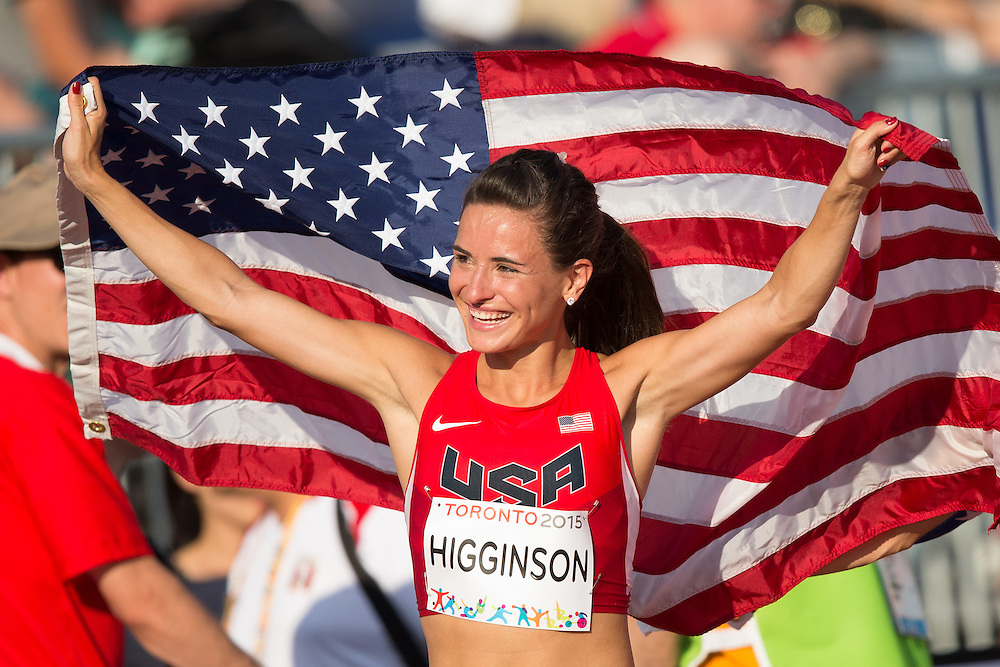 Ashley Higginson of the United States celebrates her gold medal win in the women's steeplechase at the 2015 Pan American Games at CIBC Athletics Stadium in Toronto, Canada, July 24,  2015.  AFP PHOTO/GEOFF ROBINS